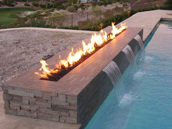 Fireplaces fire pits for pool decks san clemente for Pool with fireplace