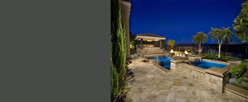 This tropical paradise is truly one of a kind. With water features and fire pits surrounding the water it is a breathtaking retreat. This pool and spa oasis is equipped with an ultra smooth pebble finish. The surrounding sanctuary includes a custom-built gazebo with built-in barbecue, sink, refrigerator, and granite topped bar and seating area.