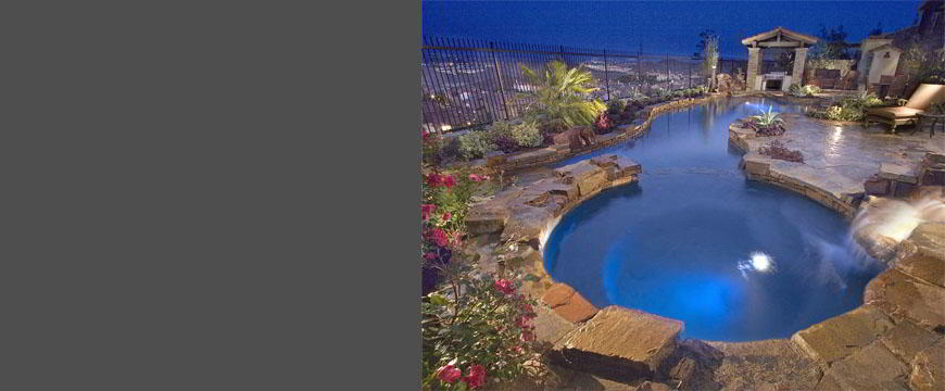 This large salt-water lagoon shaped pool and spa is designed to take advantage of the beautiful night view this back yard has. The pool and spa feature natural flagstone coping and decking with some artificial rock features. It has a large under water flagstone lounging area to enjoy the panoramic view.