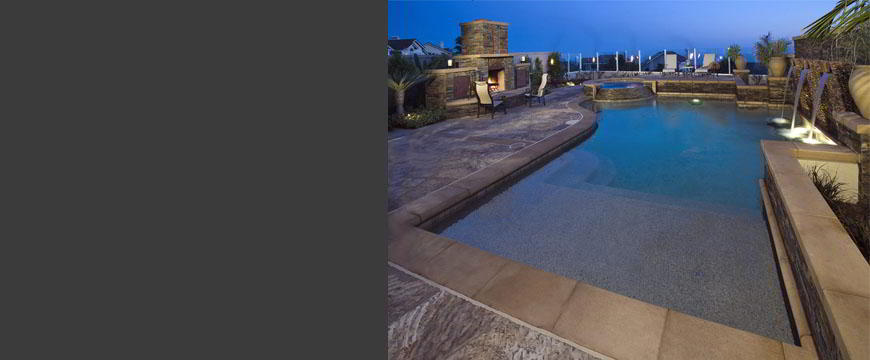 This elegant but natural back yard setting consists of beautiful saw-tooth stone decking combined with custom cast concrete coping, stacked stone 45 degree spa dam wall, large 45 degree stacked stone water feature with three spillways. Full size fireplace and hearth using stacked stone construction.